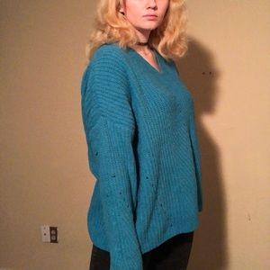 Bright blue sweater